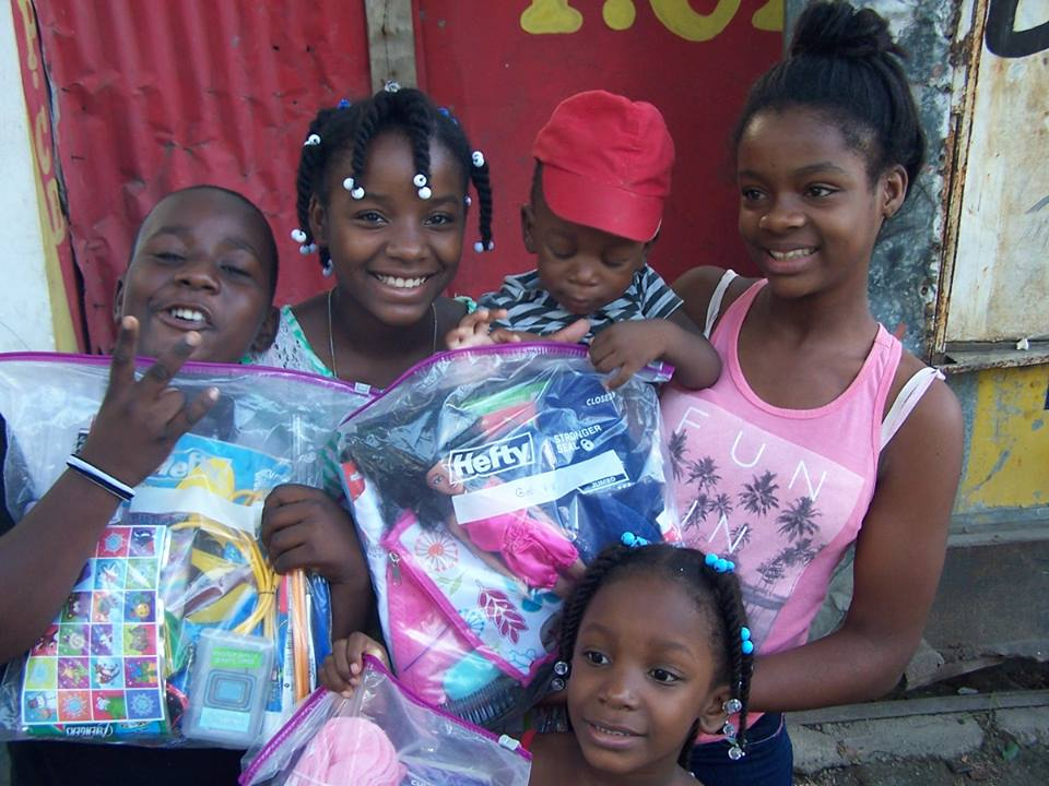 Children receiving Angel Bag Ministry - ACESNA